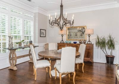 Another view of the dining area and dramatic lighting fixture with ceiling detail and wainscot in East Cobb remodeling project