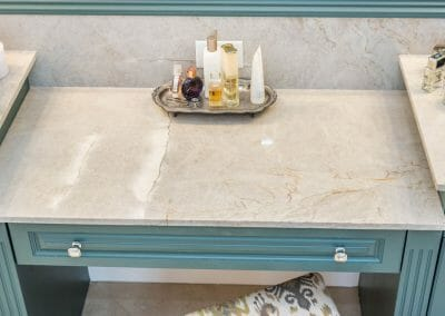 The vanity is lower than the sink countertops for comfortable seating in the East Cobb remodel