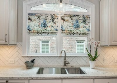 Kitchen window with sink and herringbone tile backsplash in East Cobb kitchen and first floor remodel