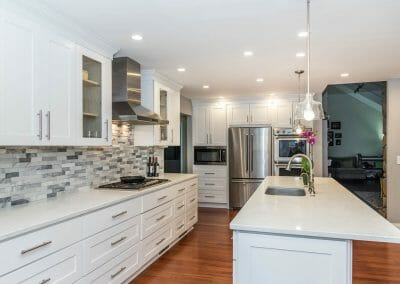 Island and cabinetry in open eat-in kitchen remodel in Sandy Springs