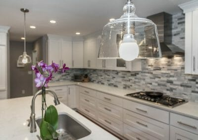 Pendants hang over the granite island in the Sandy Springs kitchen remodel