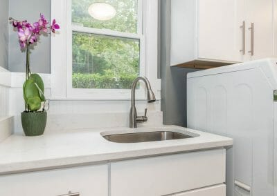 Another view of the sink in the sunny laundry room created during the kitchen remodel in Sandy Springs