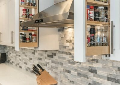 Pull-out hidden spice rack in kitchen remodeling project in Sandy Springs