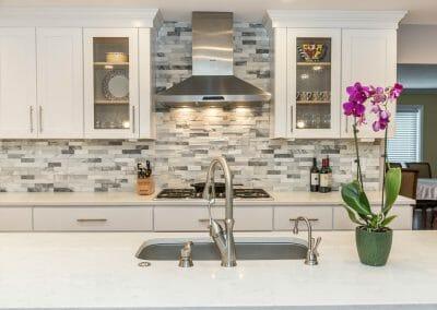 Stylish tile backsplash with white Shaker cabinets Sandy Springs kitchen remodeling project