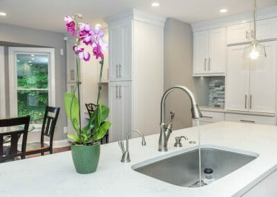 View of sink and granite counter on island of Sandy Springs kitchen remodeling project