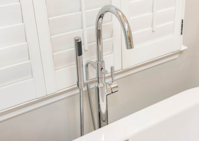 Floor-mount chrome faucet for freestanding tub, with hand shower